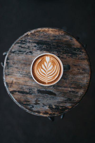A flat white on a table