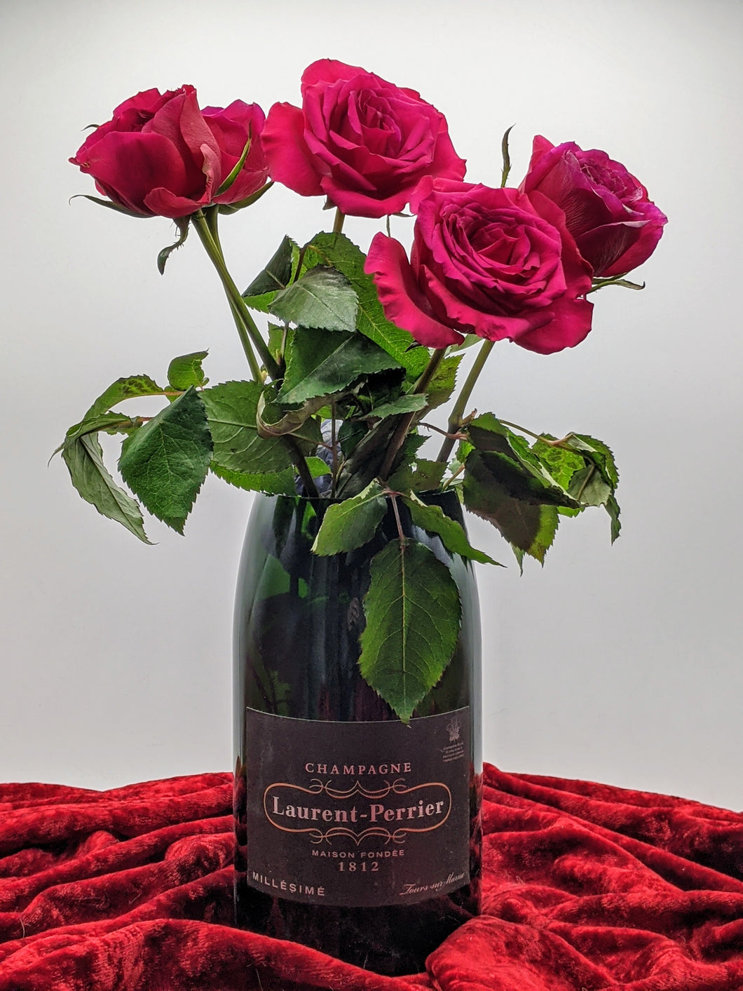 Laurent Perrier champagne bottle vase