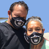 Way of the Renaissance Man Jim Woods and Mama Woods wearing their protective masks