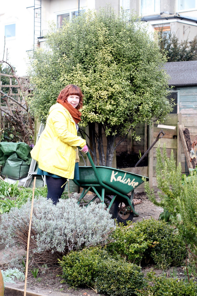 Kate and wheelbarrow at the Garden House Brighton by What You Sow.