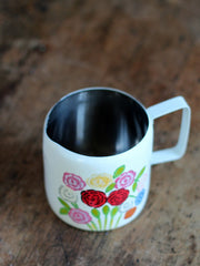 Enamel Milk jug with hand painted flowers at What You Sow
