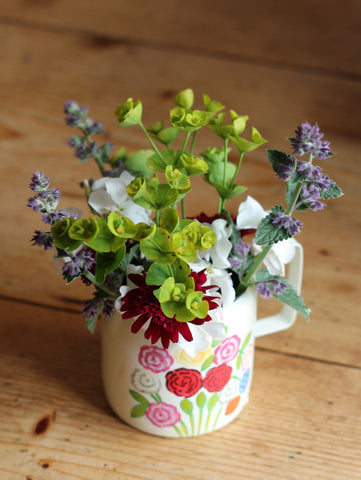 Enamel Milk jug with hand painted flowers