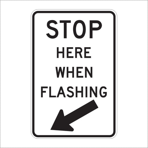 R8-10 STOP HERE WHEN FLASHING WITH ARROW SIGN