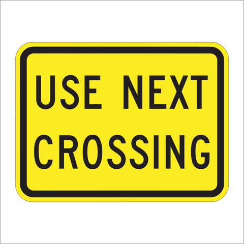 W10-14AP USE NEXT CROSSING SIGN