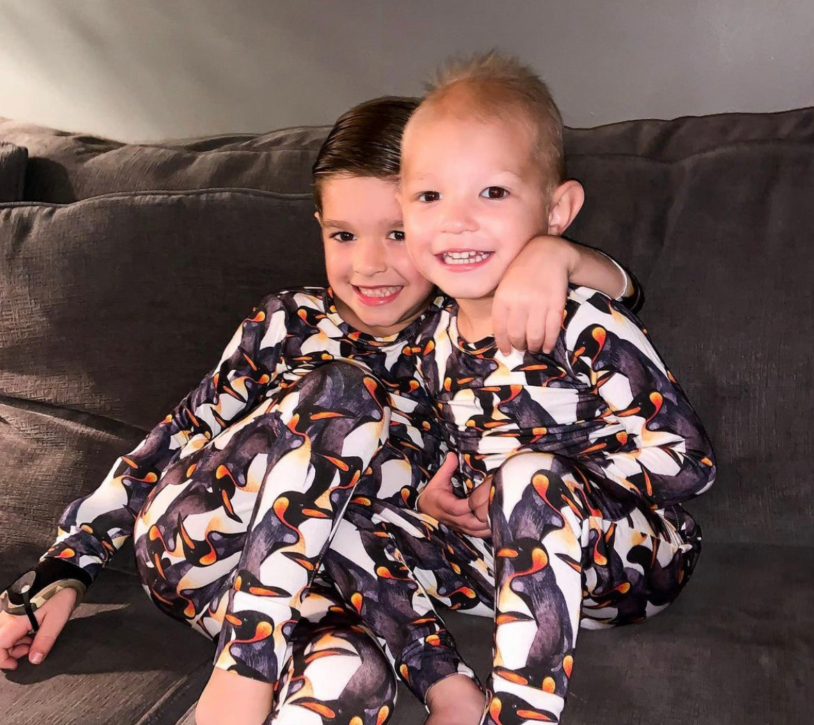 Cole and Hudson wearing Emperor Penguin Pajamas