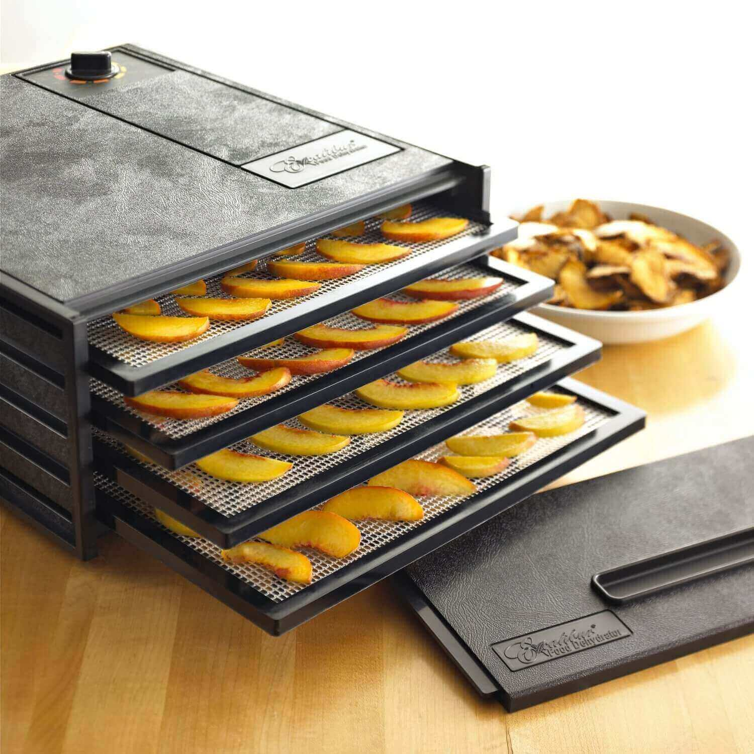 Excalibur 4400 4 tray dehydrator with fruit placed on the trays.
