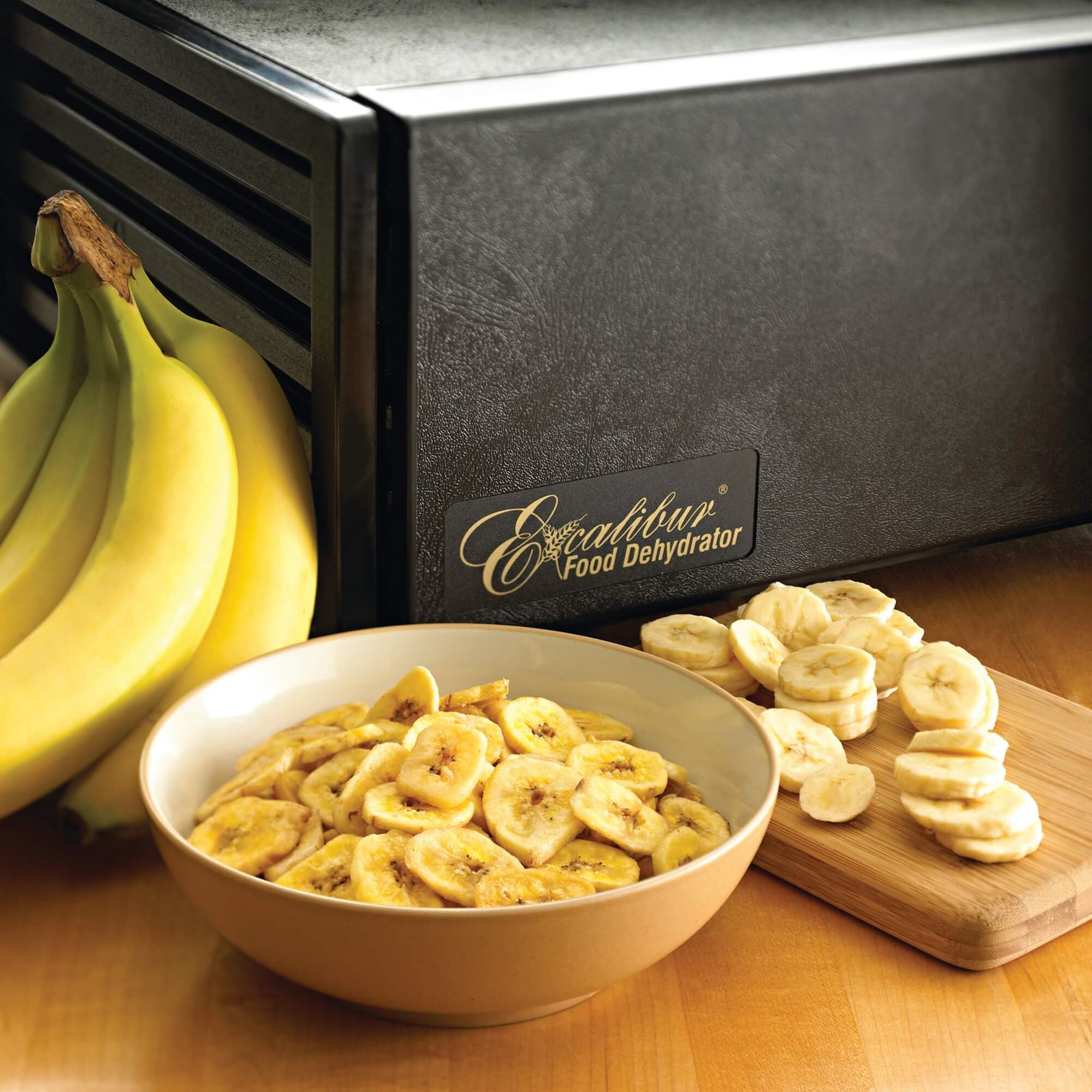 Excalibur 4500 5 tray dehydrator with banana chips in a bowl.