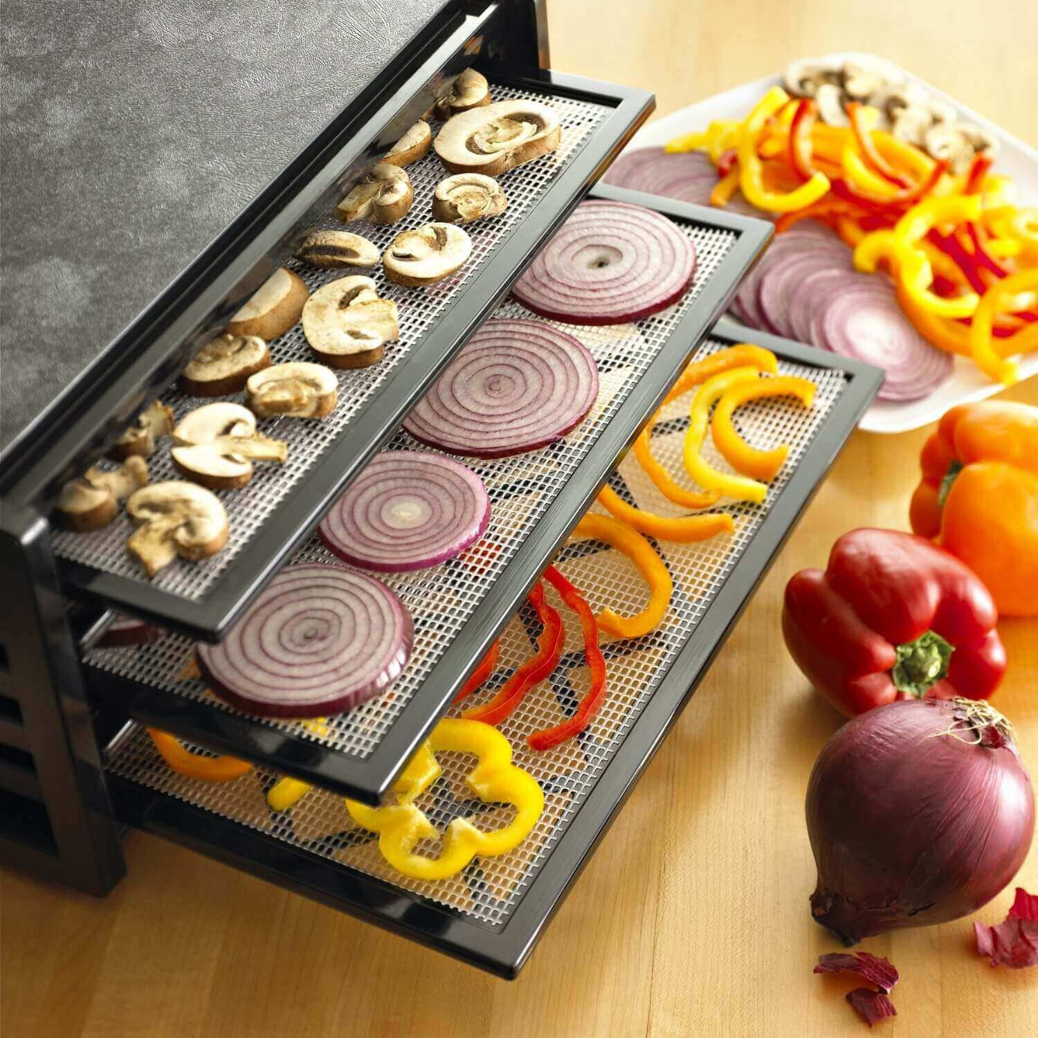 Excalibur 4400 4 tray dehydrator with an assortment of vegetables placed on the trays.