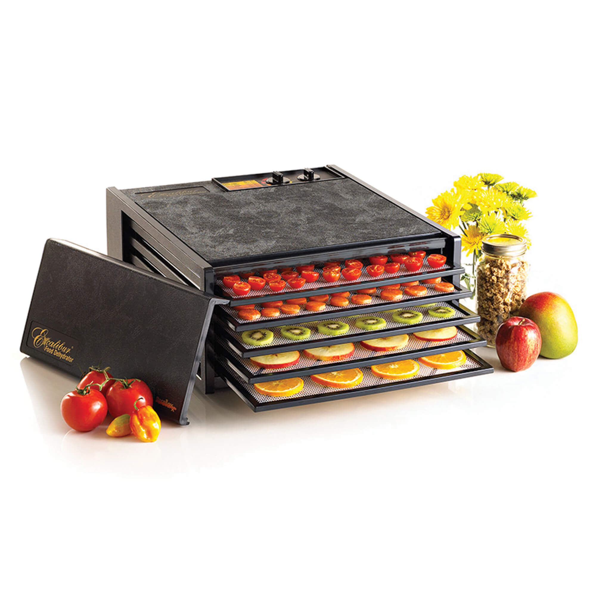 Excalibur 4526T 5 tray dehydrator with door propped to the side and food on the trays.