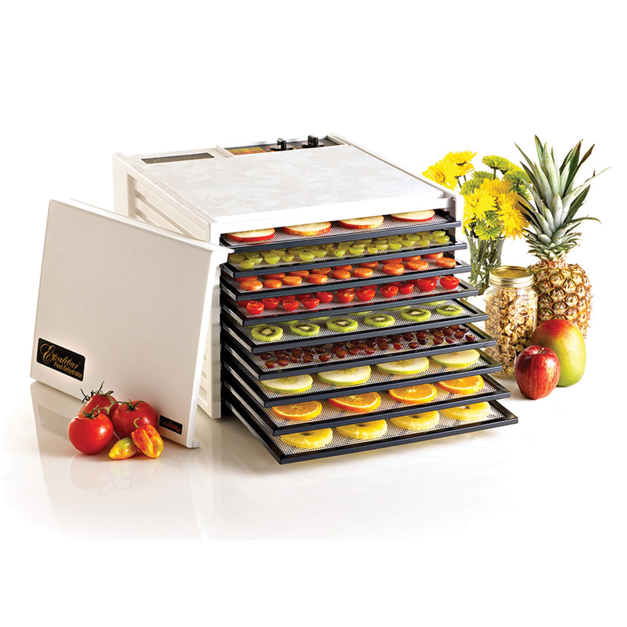 Excalibur 4926TW 9 tray dehydrator with door propped to the side, and an assortment of fruit on the trays.