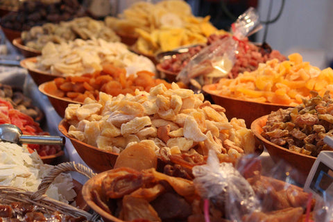 Bowls of various types of dehydrated fruit.