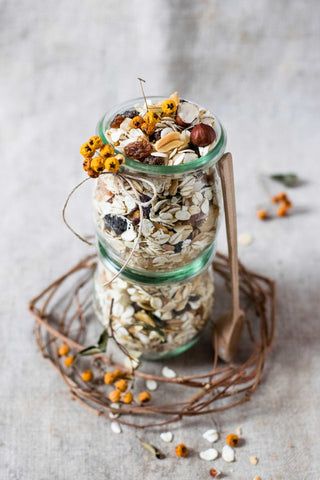 Dried grains, seeds and granola in jar.
