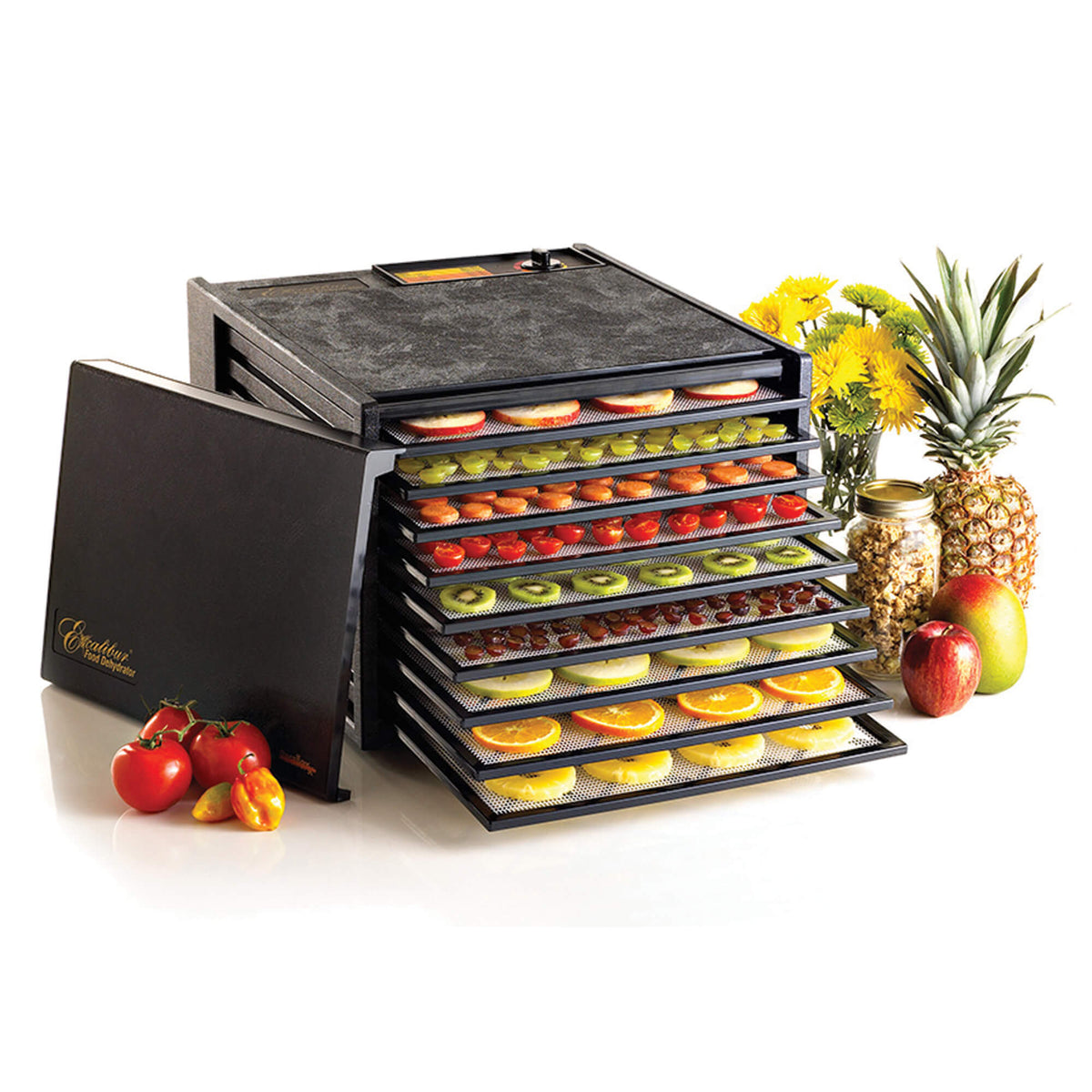 Excalibur 4900B 9 tray dehydrator with door propped to the side and food on the trays.