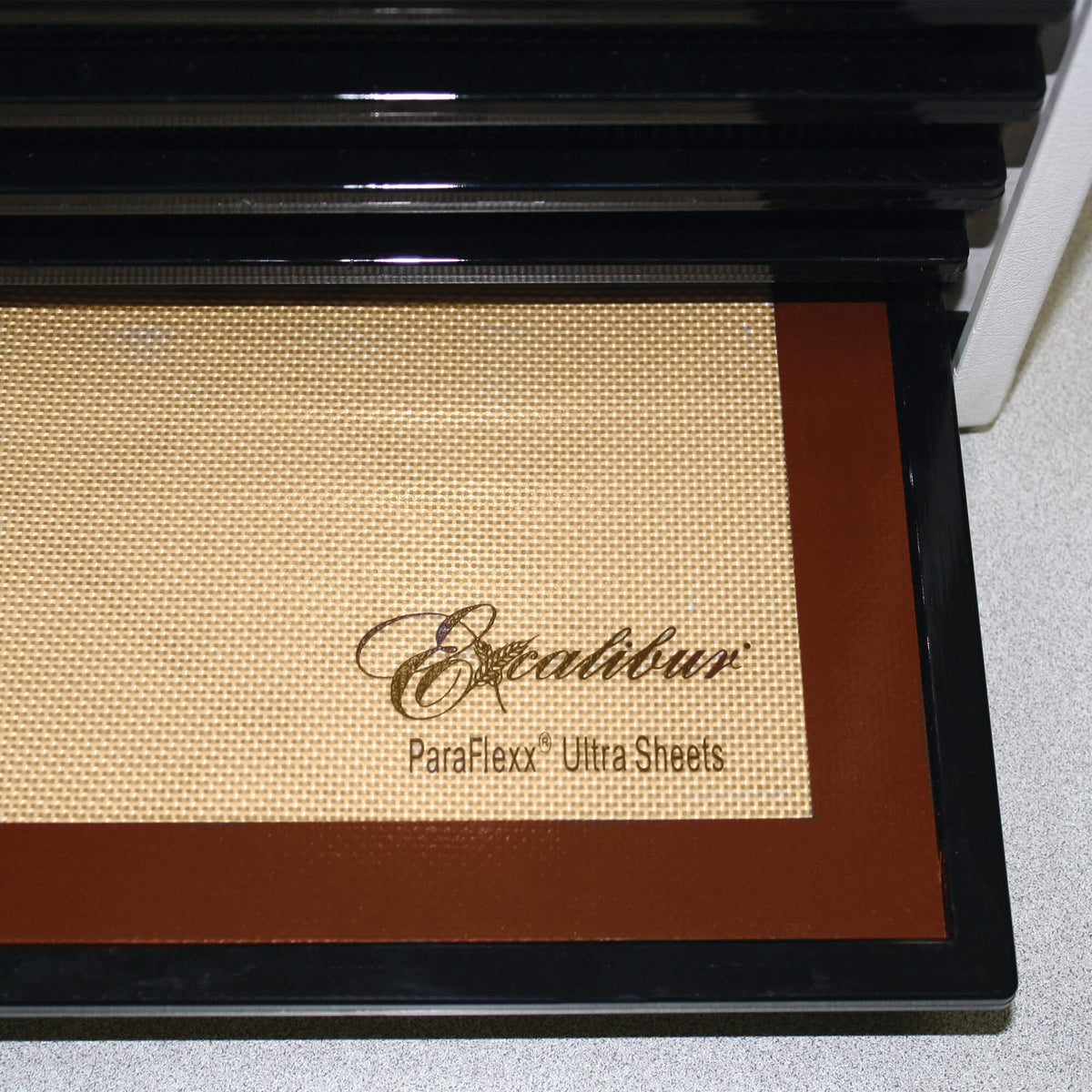 Excalibur Paraflexx Ultra silicone dehydrator drying sheet on a tray.