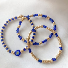 Load image into Gallery viewer, Stretchy Blue & Gold Bracelets