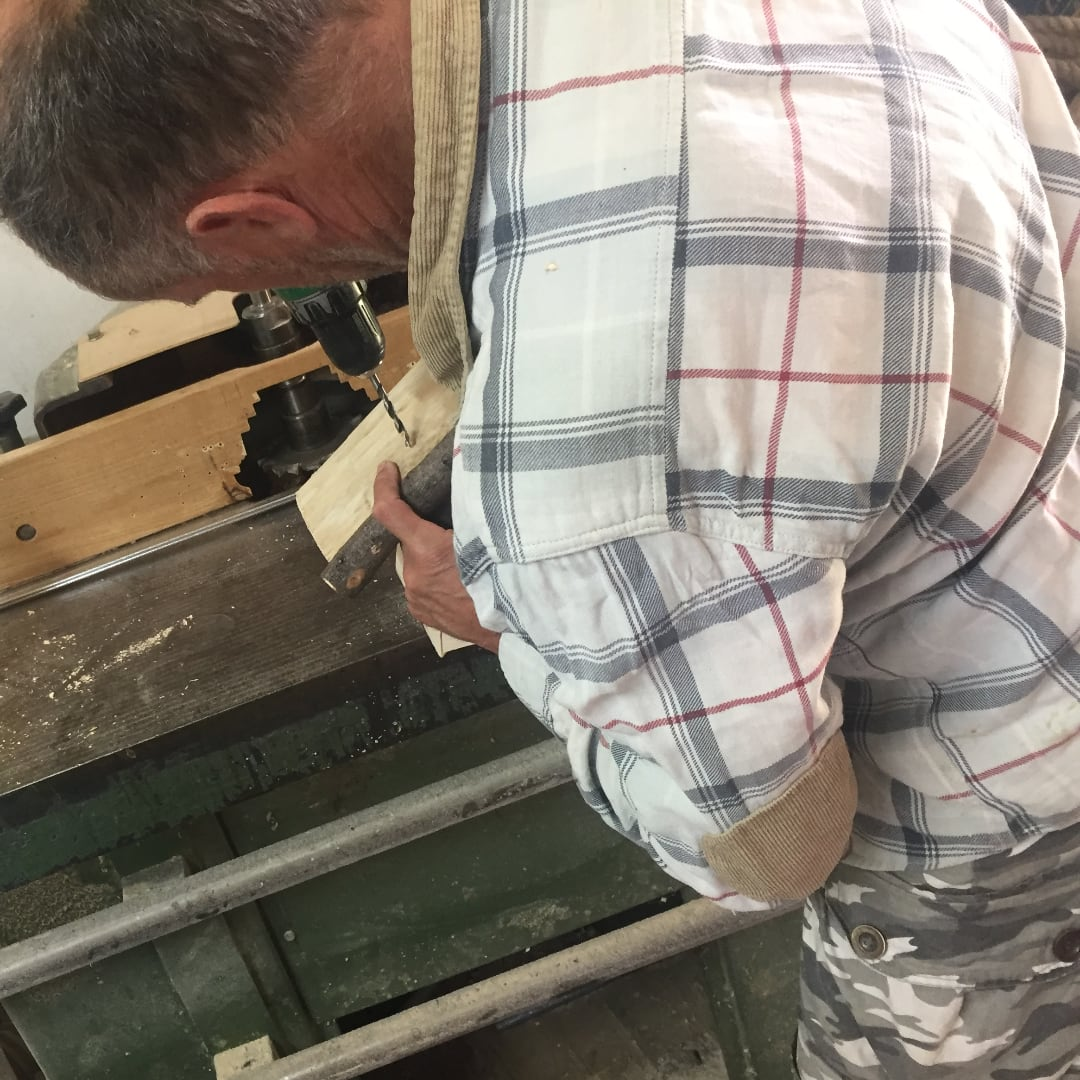 the joiner kazimierz drilling holes into bird mate house