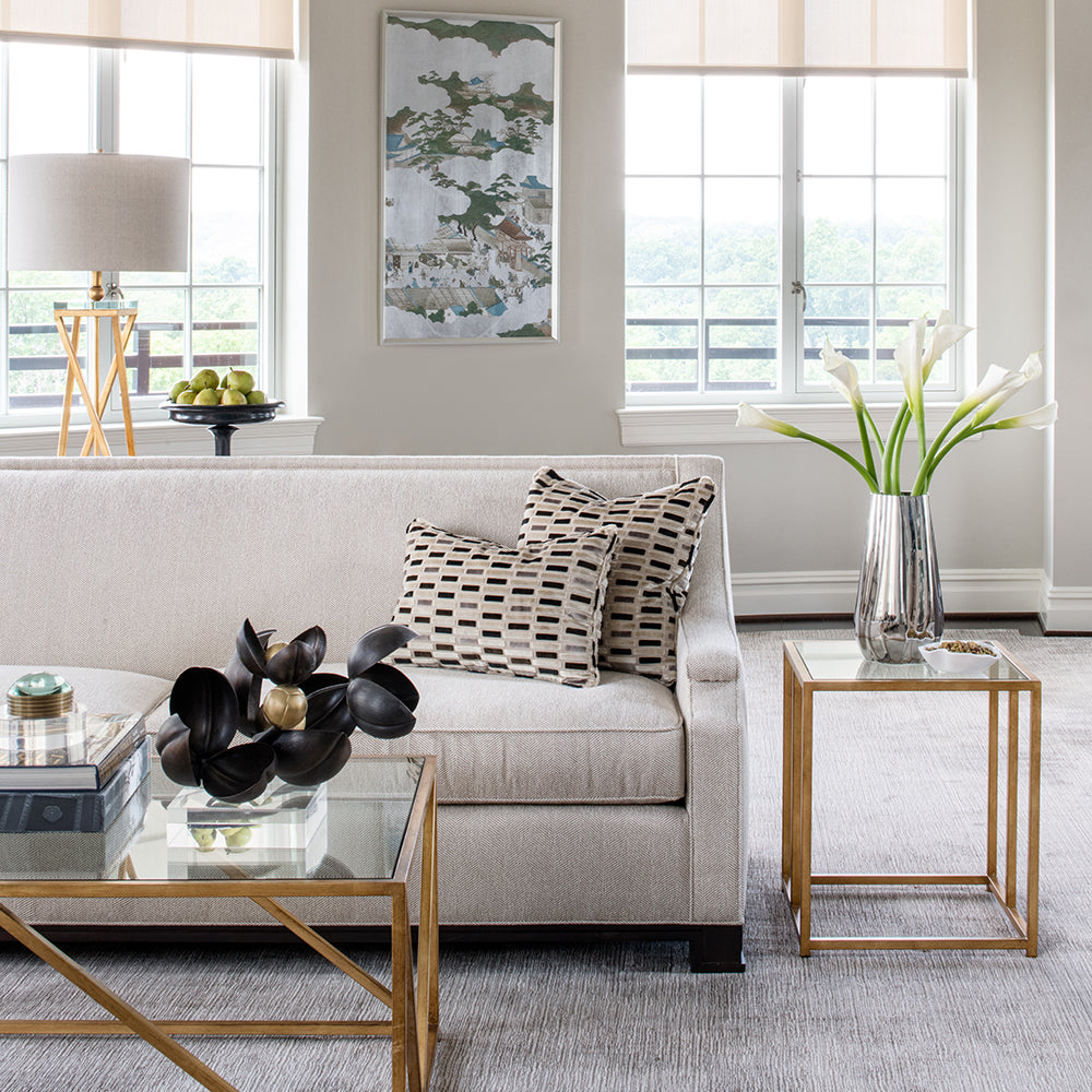 contemporary living room with neutral color palette and gold accents by Jamie Merida Interiors