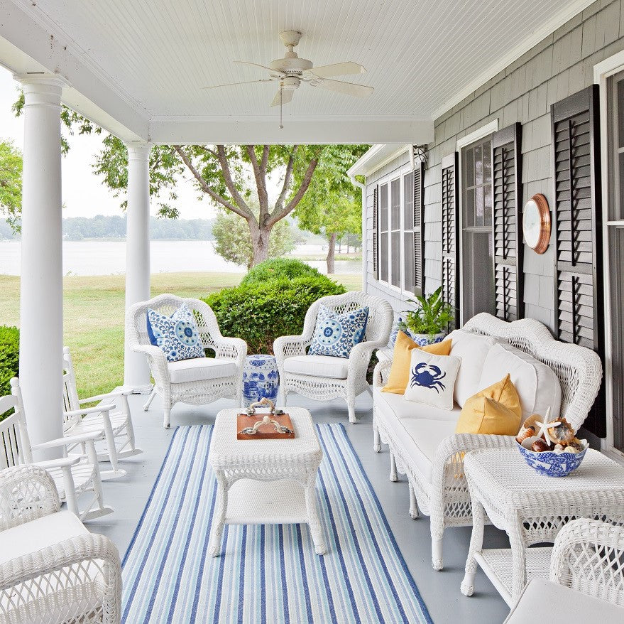 Blue and white porch overlooking a river. Farmhouse style by Jamie Merida Interiors.