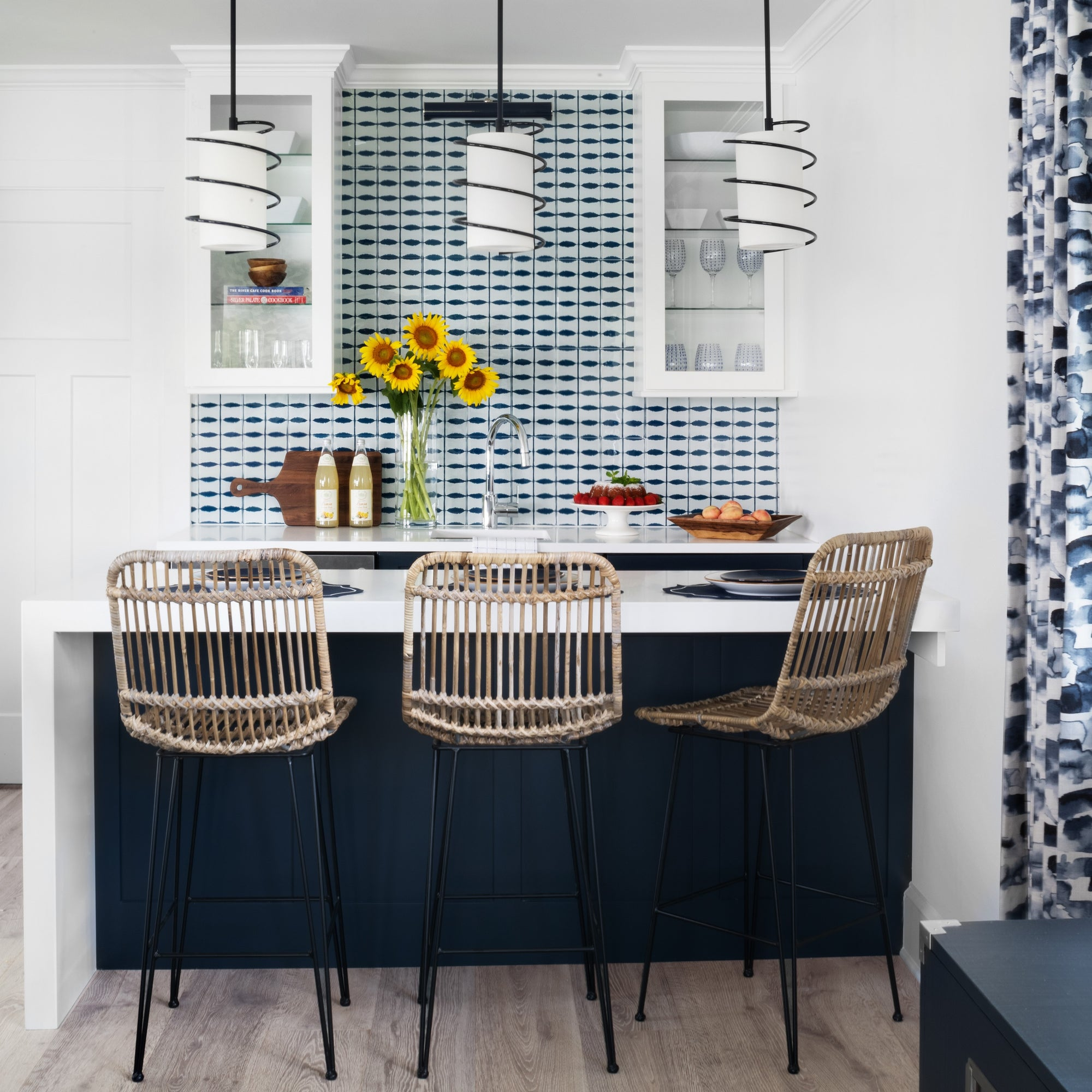 Kitchenette with blue and white backsplash tile and contemporary pendant lights. Guest cottage designed by Jamie Merida.