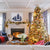 Warm living room with fireplace and brightly lit Christmas tree. Interior design by Jamie Merida.