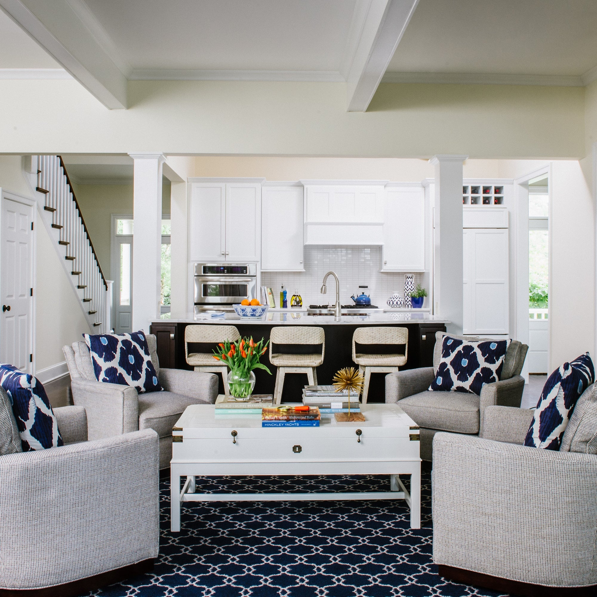 Blue & white conversation area just off a white kitchen. Jamie Merida Interiors.