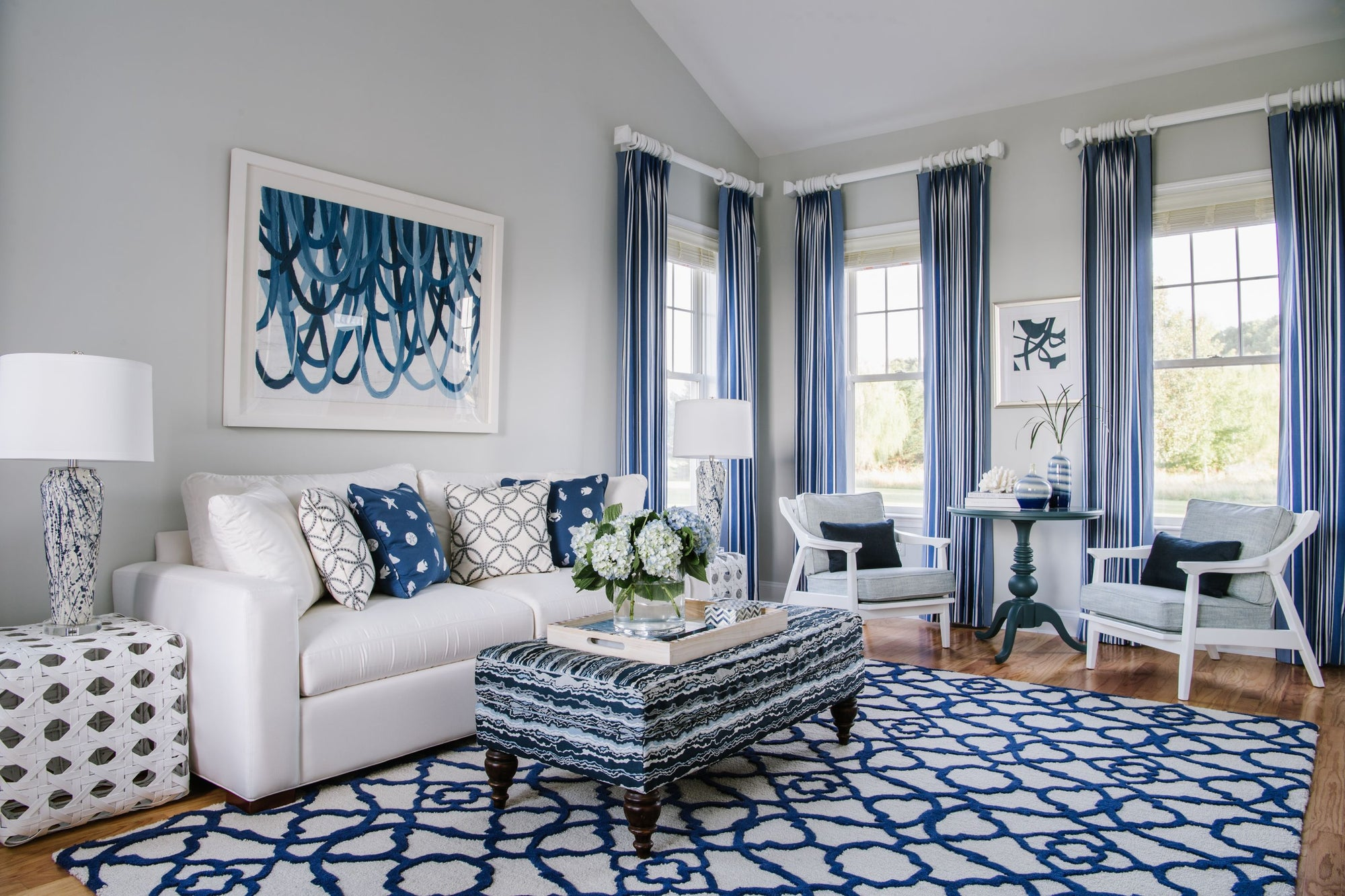 Blue and white living room designed by Jamie Merida Interiors
