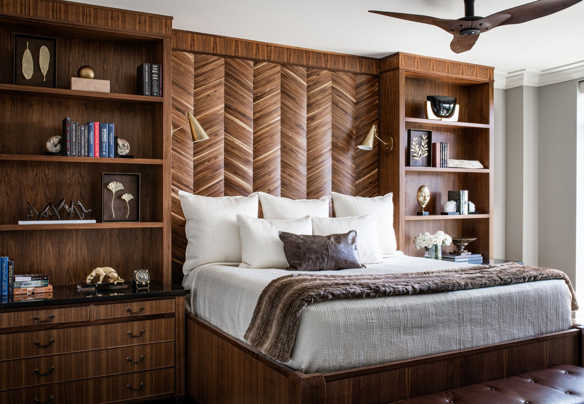 Bed with custom platform, headboard, and bookcases made with rich exotic woods. Designed by Jamie Merida.