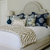 Bedding & Bath at Bountiful Home - custom chinoiserie pillows and tan and white zebra throw blanket on an upholstered bed