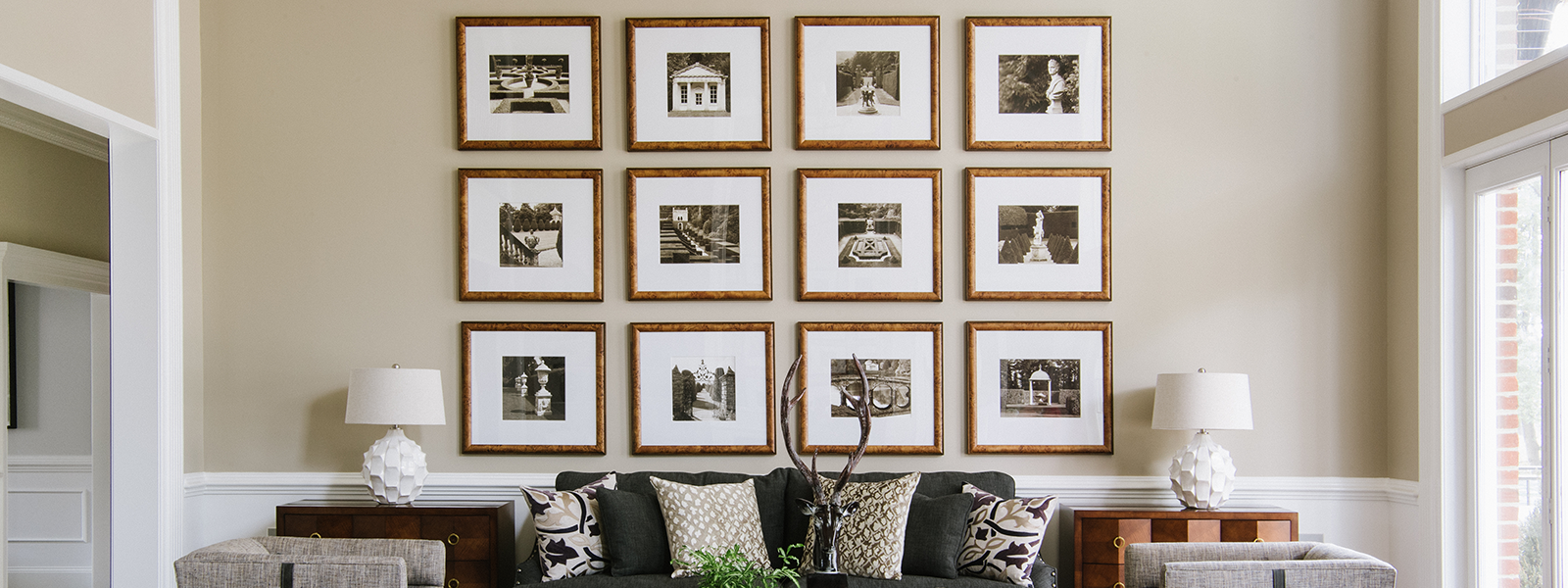 Gallery wall of black & white photos from Bountiful custom framing in Easton, Maryland