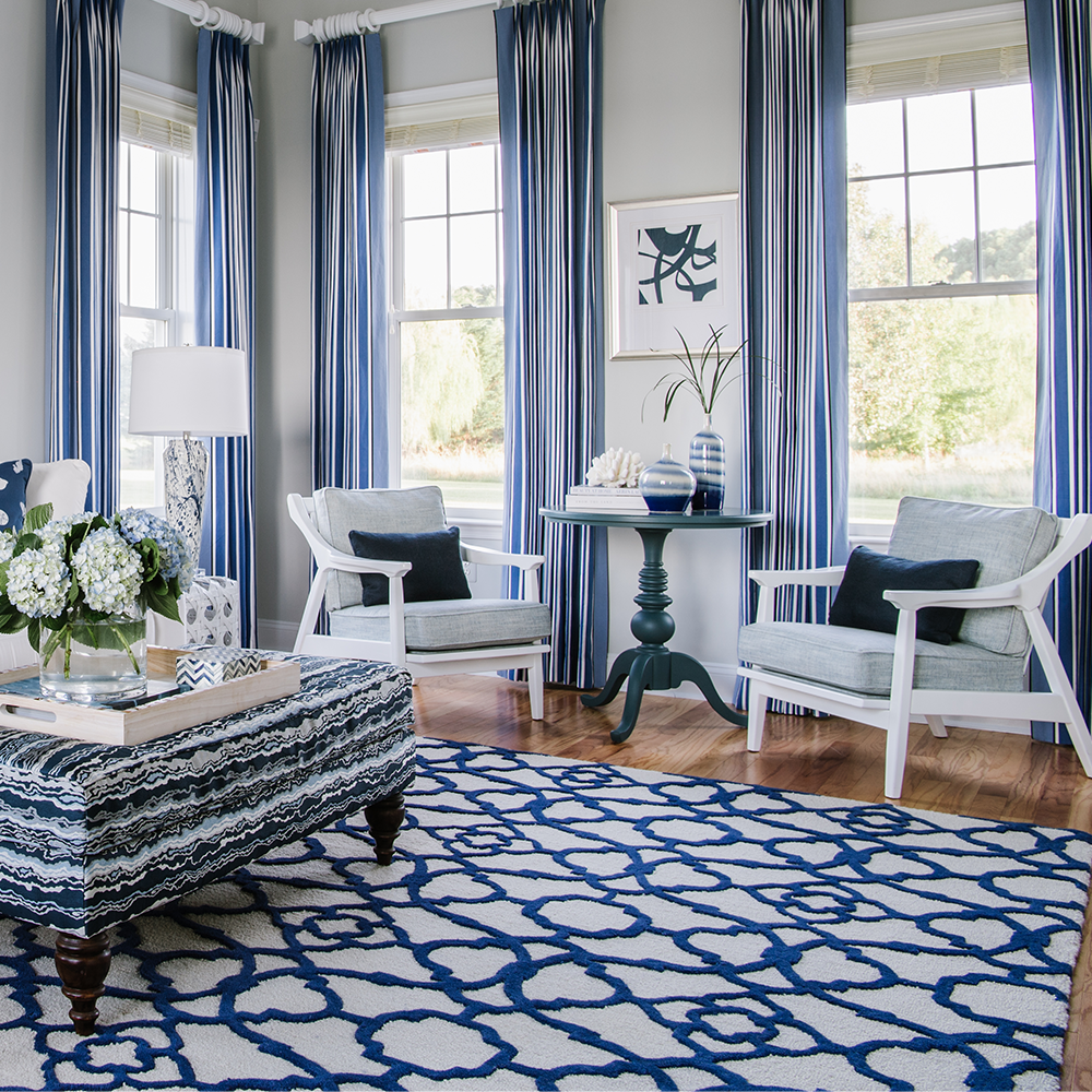 Blue & white living room with a blue & white rug with a modern pattern. Custom sized by Bountiful Flooring.