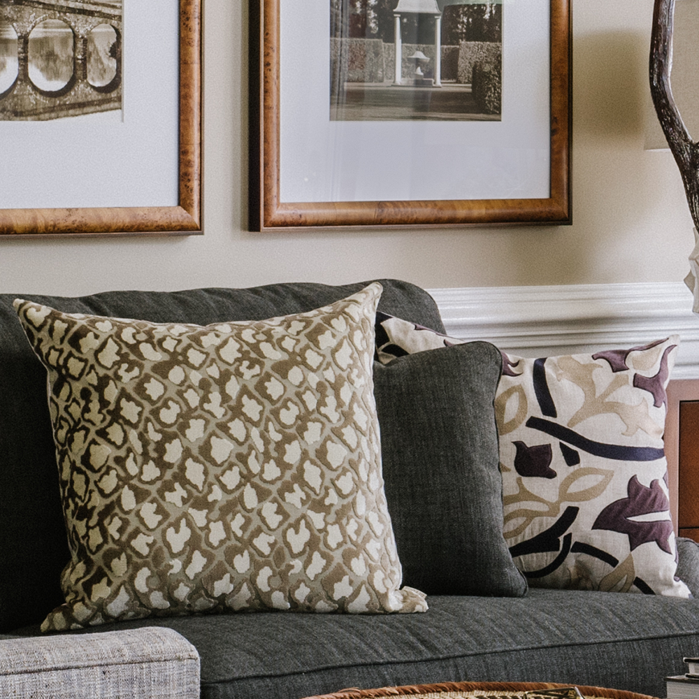 Custom made throw pillows by Bountiful Home - neutral patterns on a gray sofa