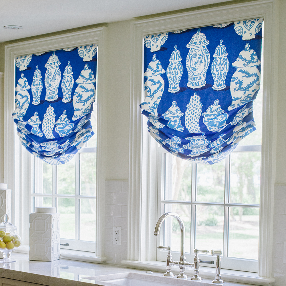 Custom window treatments by Bountiful Home - roman shades in a blue and white ginger jar pattern