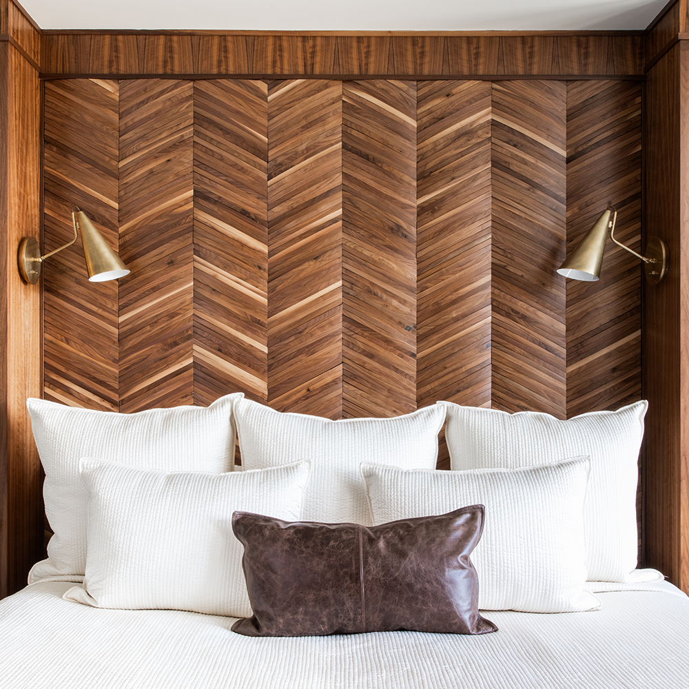Custom made headboard by Bountiful Home - exotic wood in a chevron pattern with two gold sconces