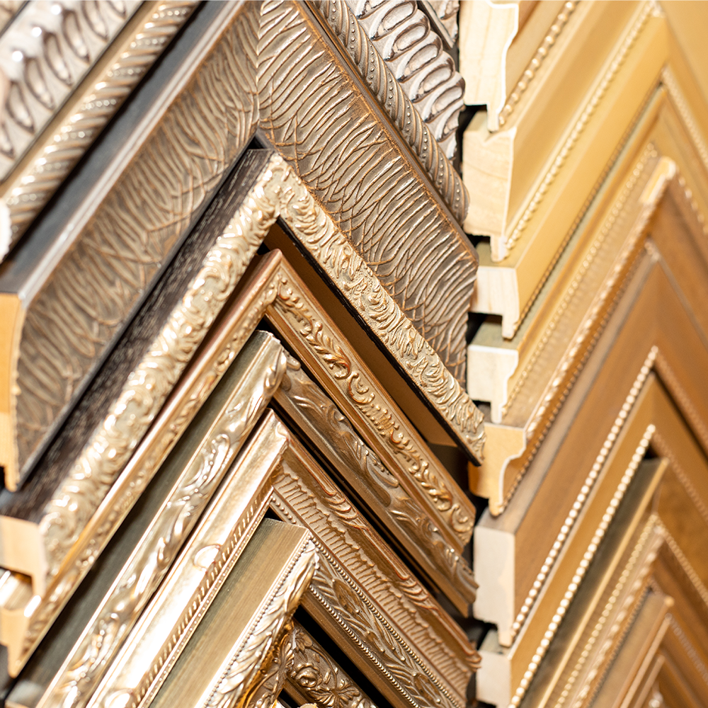 Close-up detail shot of gold-tone frames at Bountiful Framing in Easton, Maryland