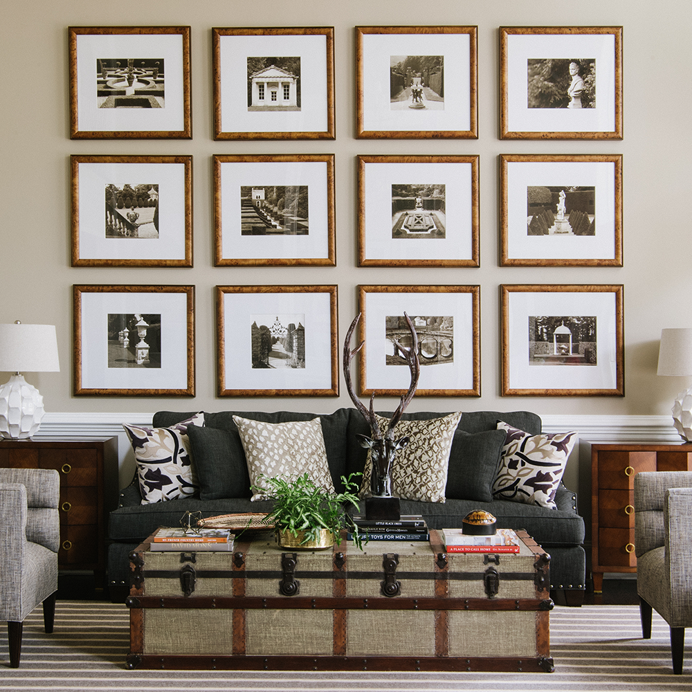 Bountiful Framing gallery wall in masculine living room space