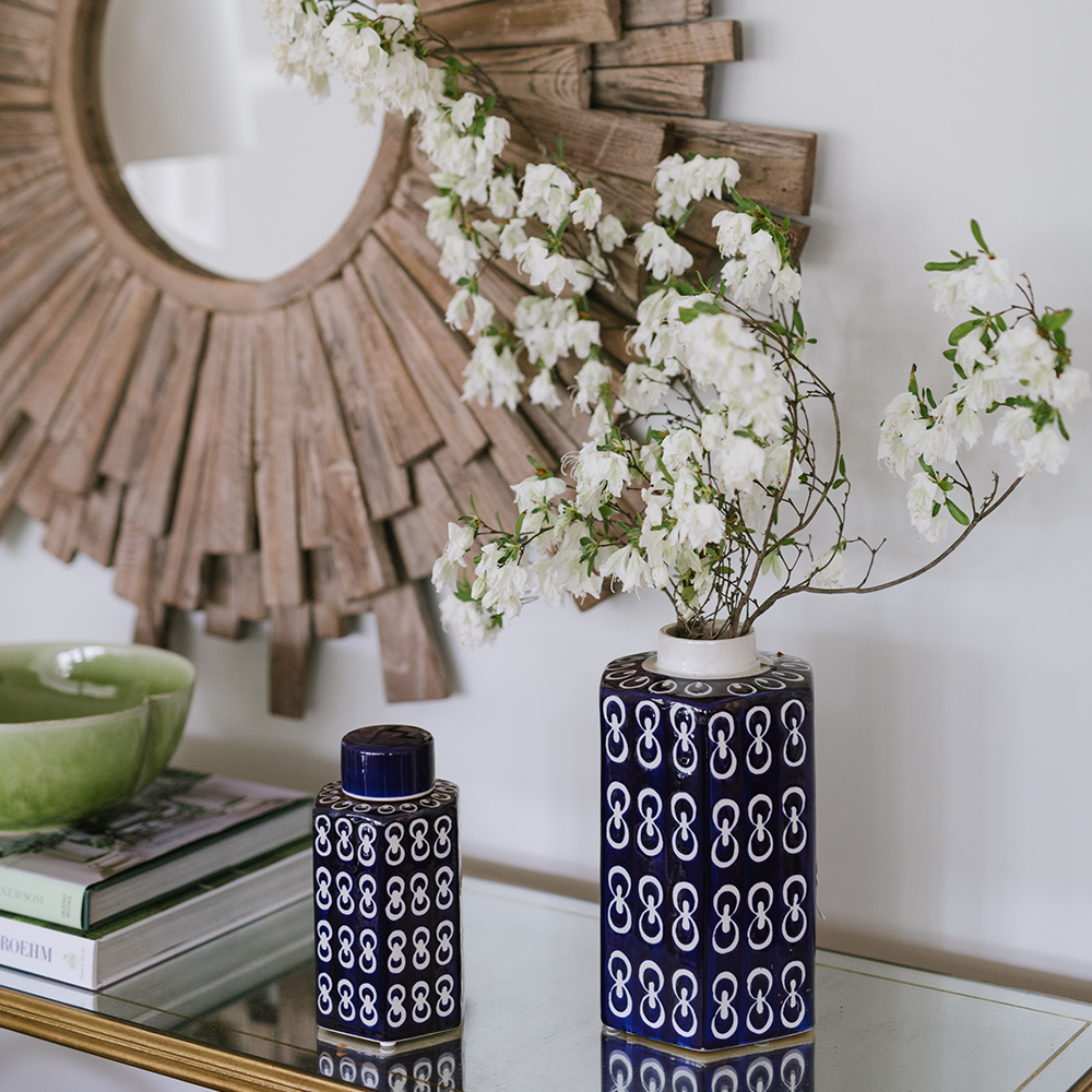 Home Accents at Bountiful Home - blue and white ceramic vases in front of a wooden sunburst mirror