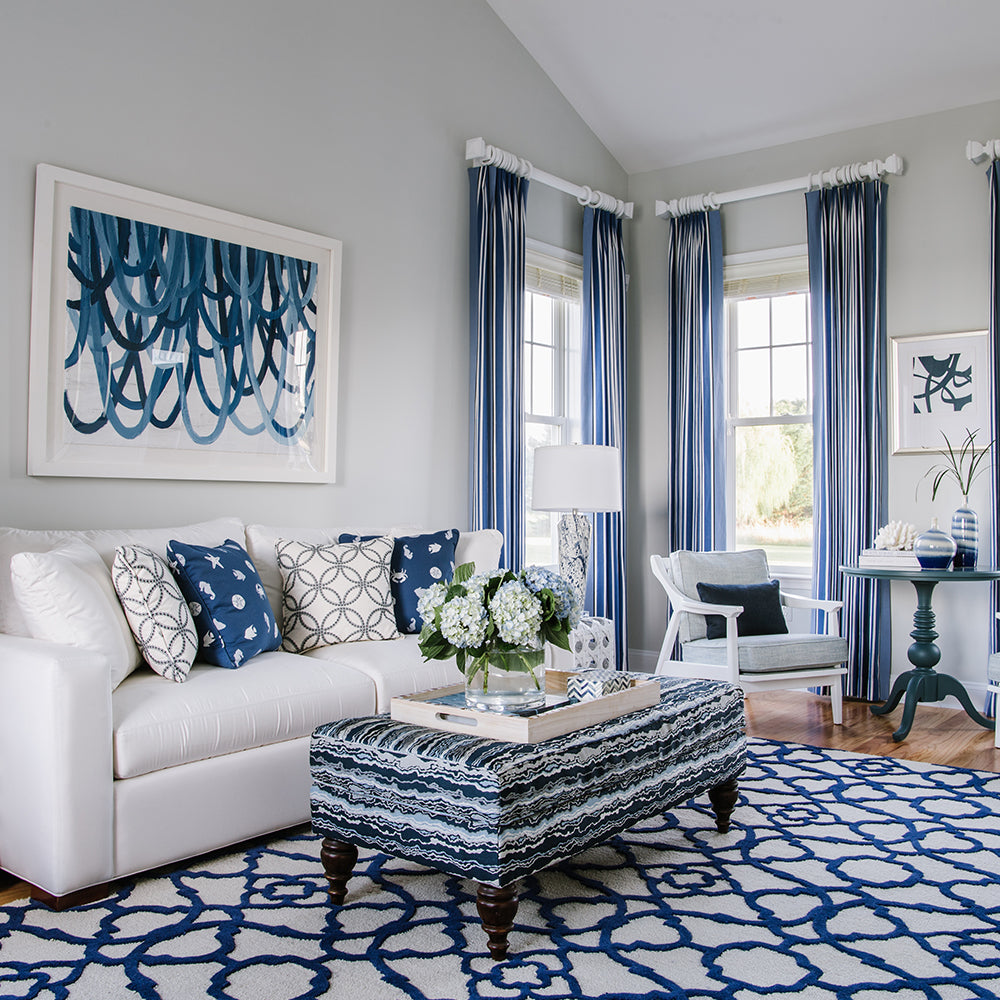 Blue and white living room design by Jamie Merida Interiors