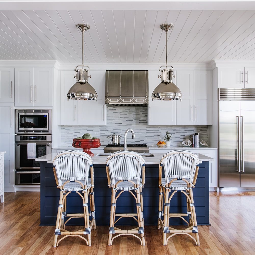 Blue and white contemporary kitchen renovation designed by Bountiful Flooring & Jamie Merida Interiors