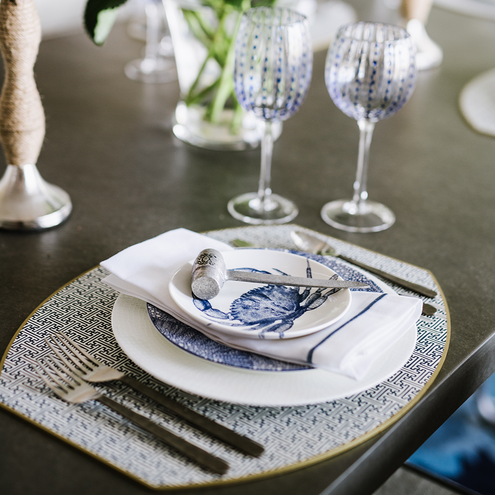 Dinnerware and glassware at Bountiful Home - blue and white place setting with crab plate and wine goblets