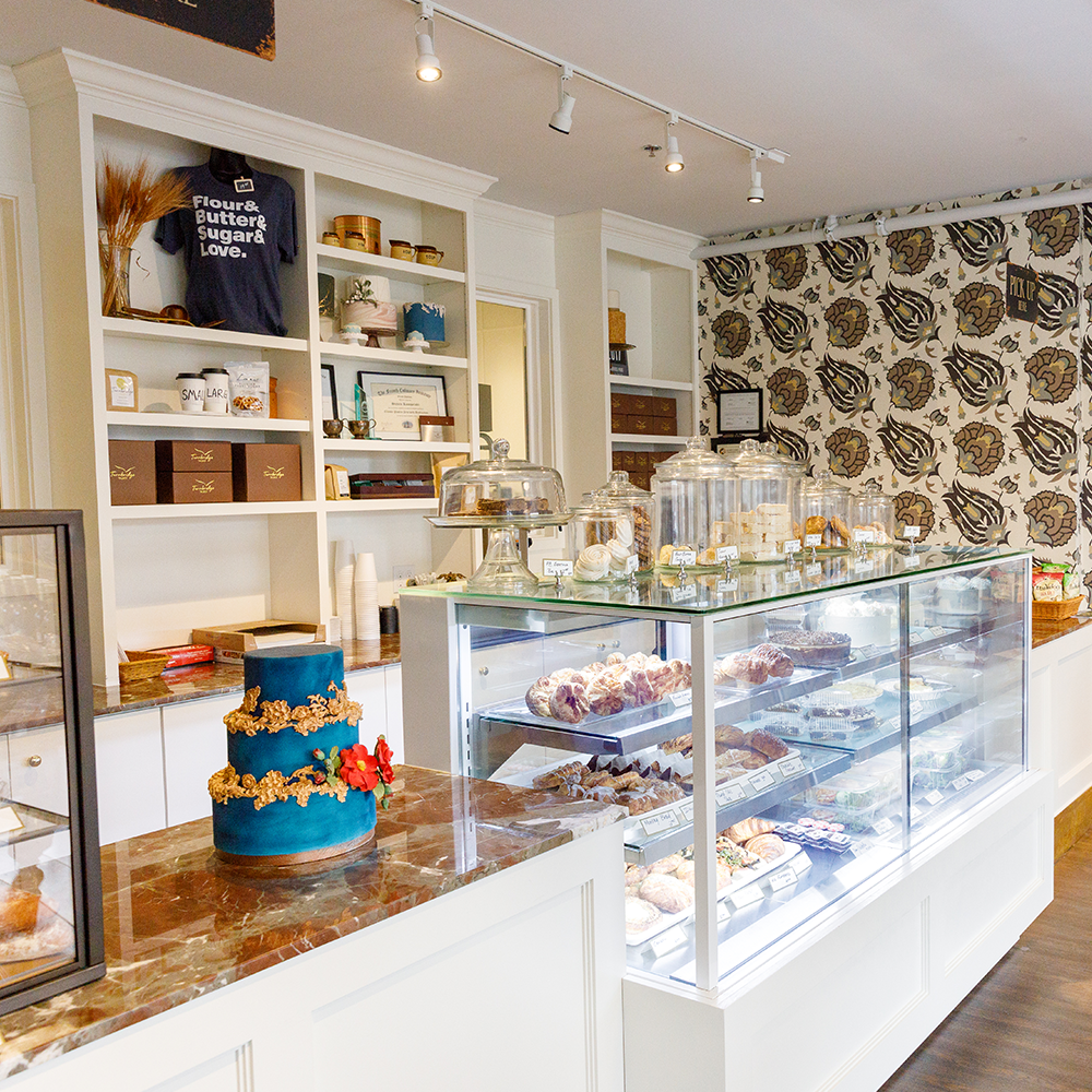 Interior shot of Turnbridge Talbot in Easton Maryland - Shows the bakery case and counter with a wedding cake