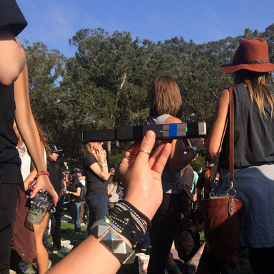 hand holding up goTenna at a the treasure island music festival