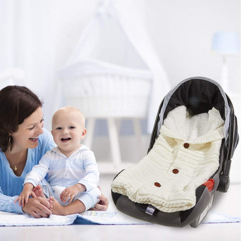 stroller with swaddle blanket with mom and baby laughing