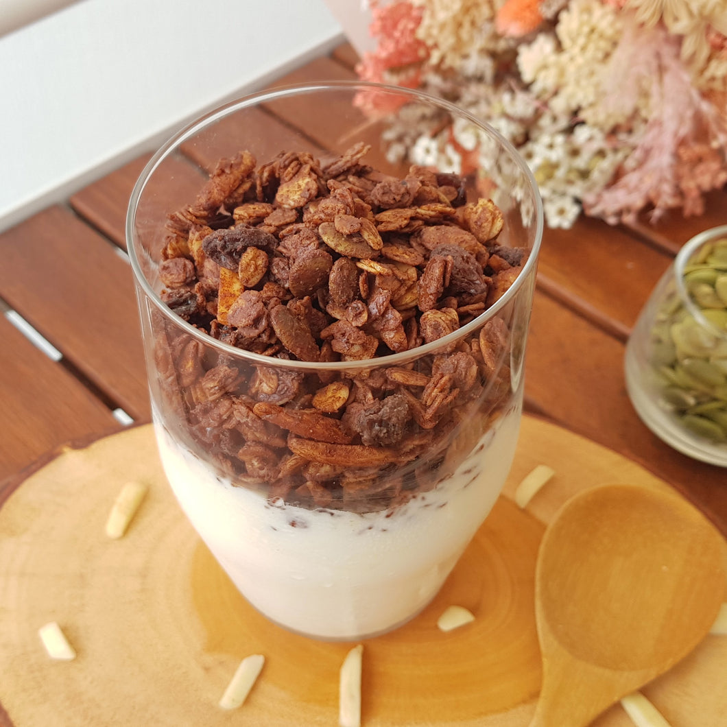 Granola with pumpkin seeds, almond and raisins generously coated with dark chocolate.