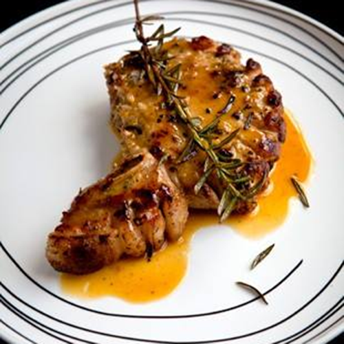 PORK CHOPS WITH GARLIC, ROSEMARY & ORANGE SAUCE
