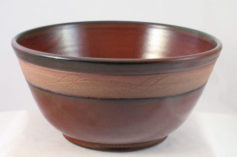iron red large mixing bowl with wave motif