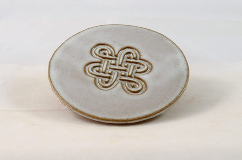 round antique white drink coaster with celtic knot