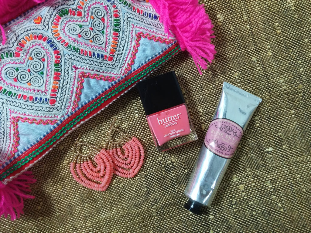 One of a kind clutches from Jade Tribe, Butter London nail spa treats and the ultimate European lotion are best paired with a viv&ingrid gold and natural coral Peacock Chandelier