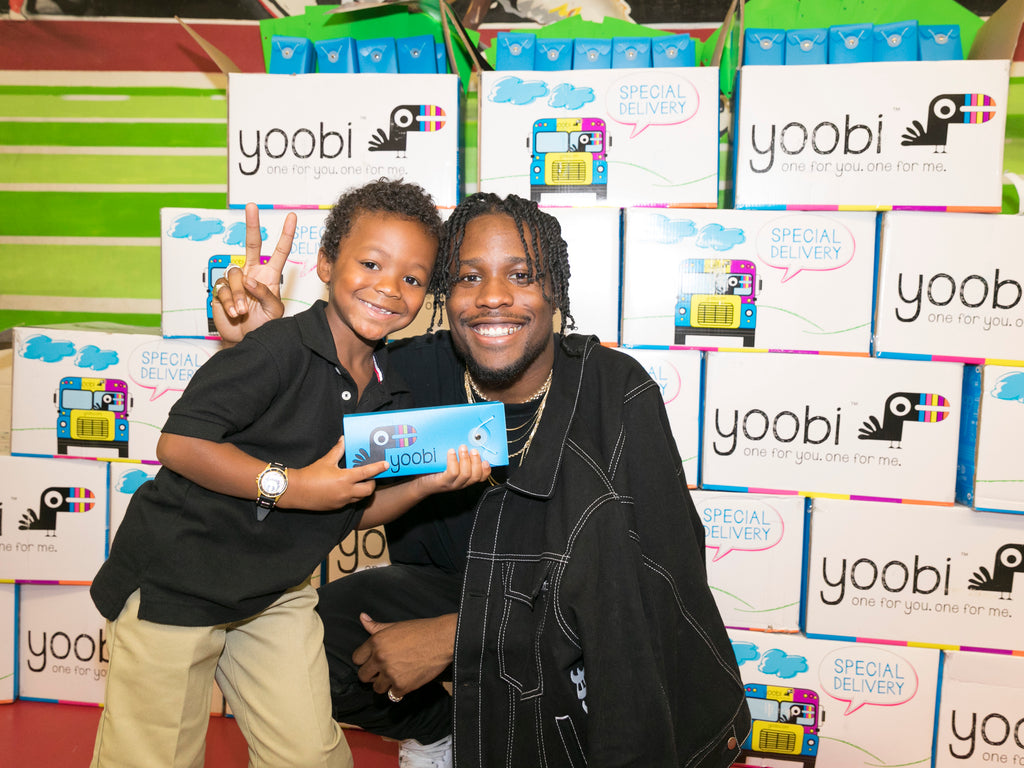 Shameik Moore giving free school supplies to students at Hambrick Elementary School