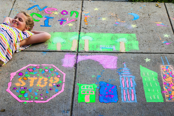 Author and content creator Rebecca Green shows how to create your own sidewalk chalk mural. Sidewalk art is a fun and creative way to make art and is the perfect family outdoor activity. Learn more!