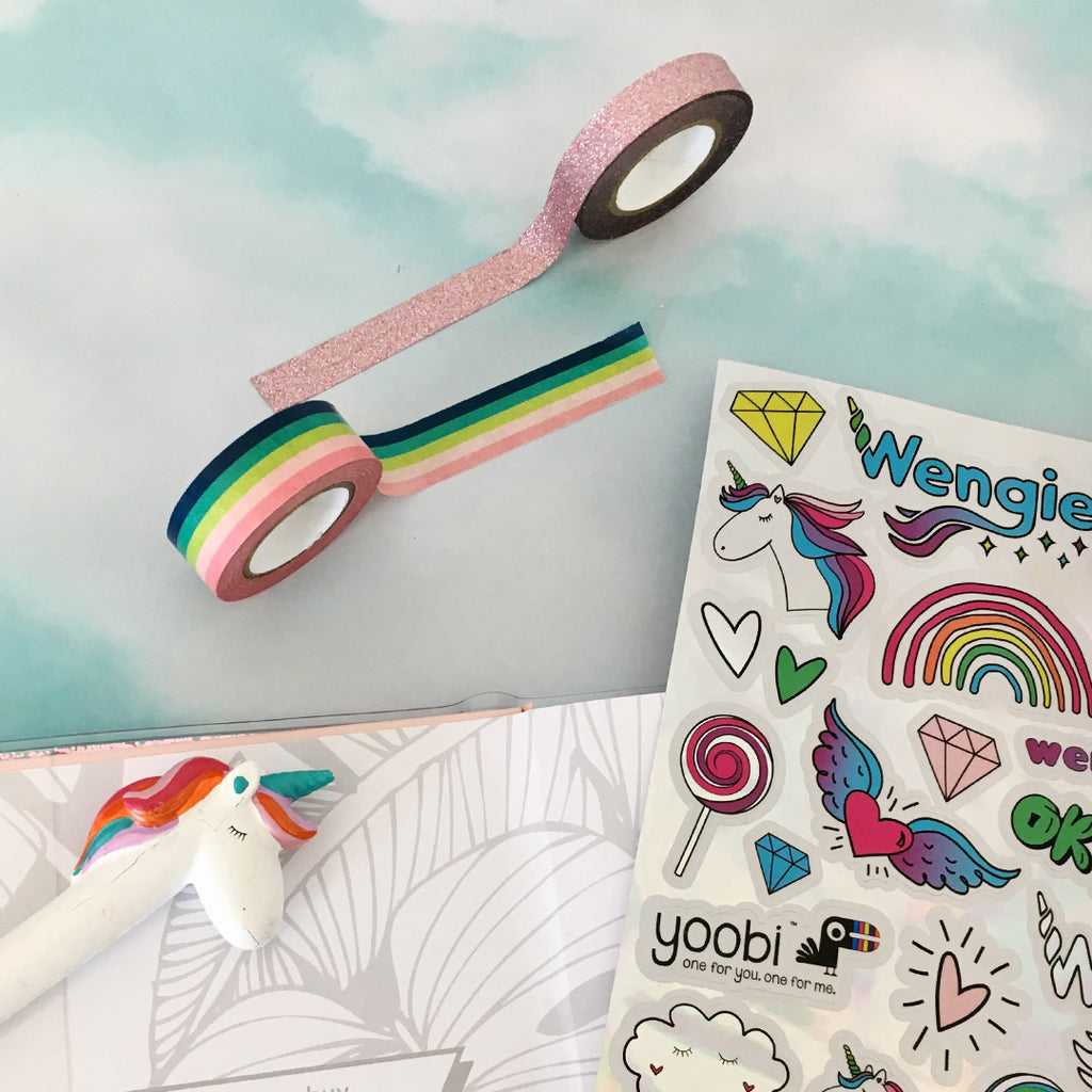 Take a look at Wengie's absolutely essential back to school supplies. This exclusive Wengie x Yoobi collaboration brings you a limited edition box filled with magical goodies. From a glitter journal, unicorn pen and pencil case to washi tape and a custom designed sticker sheet.
